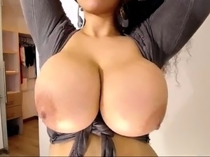 Busty MILF is toying her mature pussy