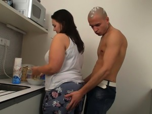 Busty big belly brunette fatty rides cock on the kitchen