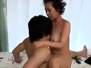 Hot Japanese granny with big boobs orgasms on a young cock