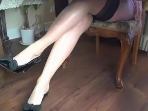 Pantyhose footjob under table