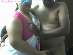 Indian auntie caught on webcam giving a blowjow to a stranger