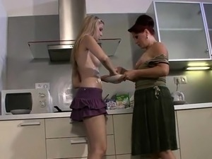 Blonde teen and mom go lesbian on kitchen