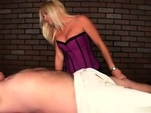 Bodacious blonde masseuse works her gifted hands on a cock