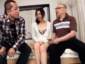 Kinky Asian wife gives a hot handjob in front of her husband