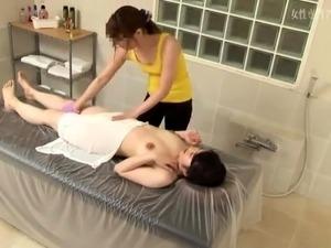 Beautiful Asian babe made to cum hard by a lesbian masseuse