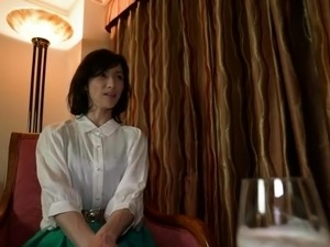 Horny Japanese mom drops her clothes and enjoys a hard cock