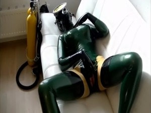 Diving on the sofa in latex