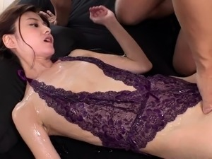 Lovely Oriental babe in lingerie gets oiled up and fucked