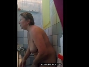 My mom 54 masturbates after showering