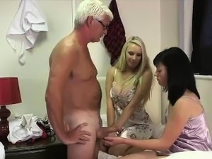 Older guy gets handjob from naughty British CFNM girls