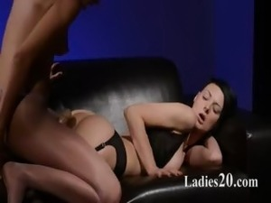Horny brunette sucking cock of rubber