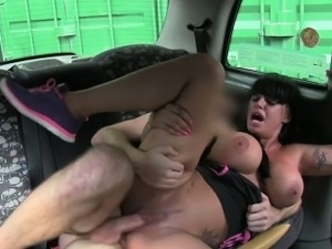 Huge tits tattooed babe fucking in fake taxi