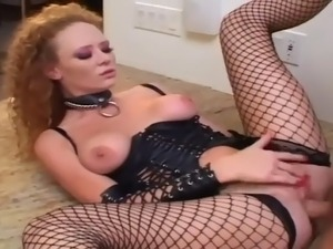 Bossy redhead wearing a leather corset and fishnets deepthroats and fucks