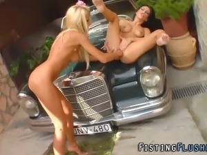 Pussy fisted lesbians squirt on each other outdoors