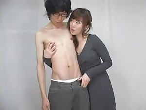 Skinny Asian boy is seduced by Asian girl and gets his cock sucked