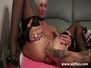 Brutally Fisting her massive snatch till it squirts free