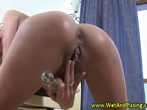 Goldenshower wam babe plays with her pussy in her piss