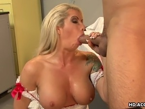 Attractive mature nurse with a pair of large melons wanks her patient's stiff...
