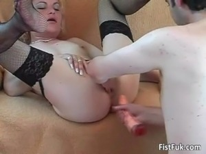 Blonde slut in stocking spreads legs free