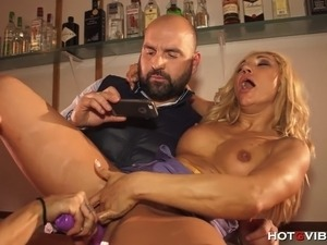At the behest of the bar patrons, busty porn stars Gigi Love and Ginger Hell...