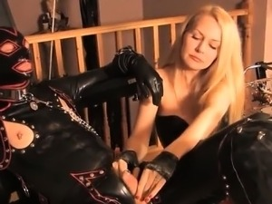 BDSM femdom masochism in latex with a blonde