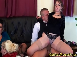 Piss drenched sluts get soaked in fetish watersports action