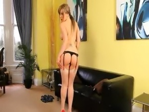 Beautiful chick teasing at home in shoes