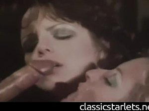 Juliet Anderson and Holly McCall double team Billy Dee in this scene from the...