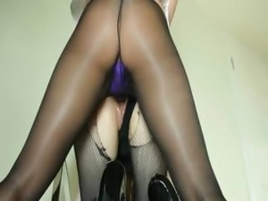 Secret beauties sucking strap on dildo