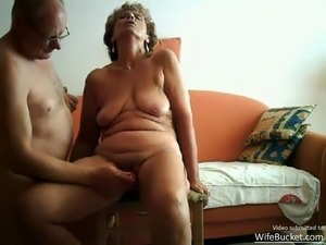Video of a real couple having sex on their orange sofa, posted by WifeBucket.com