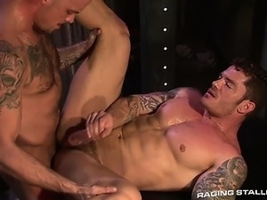 Furry tatted Caleb's cock impales hard-bodied giant Mitchell