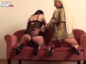 Two horny German lesbian amateurs start of showing their dildo skills to each...
