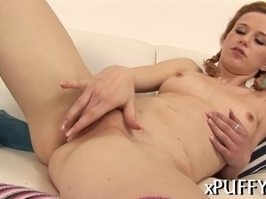 Rubbing her shaved beaver makes gorgeous lass horny for more