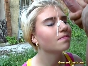 Behind a car, this racy slut gives fine blowjob and has her shaved poonanie...