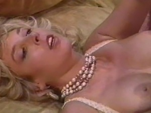 Busty retro babe Victoria Paris and Peter North fucks around the living room....