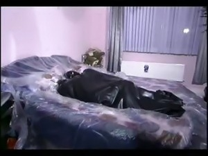 Couple in latex outfits fucking on bed