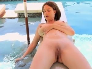 Big-breasted MILF Kelly Capone masturbates in the hot tub