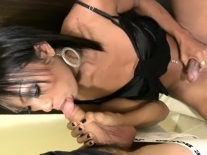 Asian t-girl in black robe is pleasing and sucking huge cock