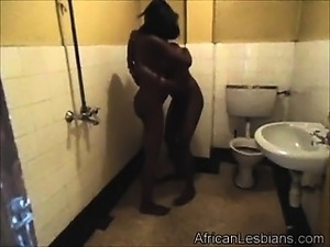 Horny lesbians having fun in the public toilete