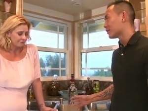Tattooed Japanese fellow makes love the Sexy Blonde Milf inside A Kitchen