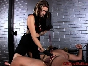Beautiful dominatrix is delighted to punish a hunky masked guy