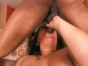 Horny brunette likes a big black cock between her legs