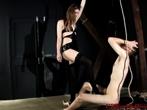 Sexy dominatrix ties up this young guy to play with his boner