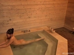 Two pretty Asian babes going full-lesbian in the sauna