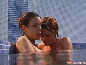 Alluring lesbian teen messing around in the swimming pool hardcore