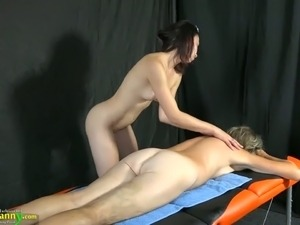 Slim brunette gives massage to horny old chick who gets her muff fucked with...