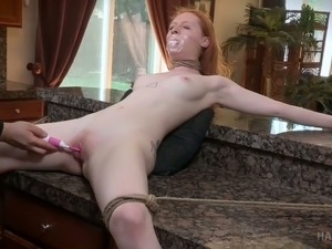 Red haired chick Ruby Red gets punished on the floor