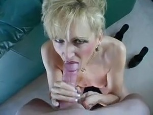 She swallows cum behind the couch
