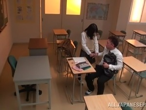 Japanese college girl gets her pussy fucked in the standing position