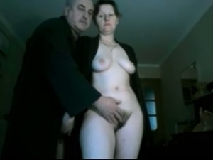 Playing with my wife's hairy snatch in front of a camera